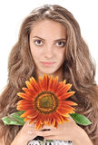 Beautiful woman with long hairs holding sunflower Royalty Free Stock Photo
