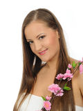 Beautiful woman with long healthy hair and flower Stock Photo