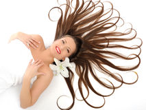 Beautiful woman with long healthy hair relaxing Royalty Free Stock Photos