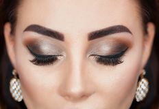 Beautiful Woman with long lashes and beautiful make-up in a beauty salon. Eyelash extension procedure stock photos