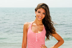 Beautiful woman with long pink dress on a tropical beach Stock Photography