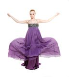 Beautiful woman in long purple dress Stock Image