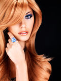 Beautiful woman with long red hairs with blue makeup Stock Photo