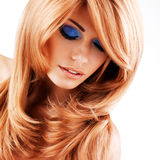 Beautiful woman with long red hairs with blue makeup Stock Photos