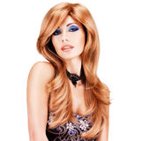 Beautiful woman with long red hairs with blue makeup Royalty Free Stock Image
