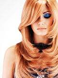 Beautiful woman with long red hairs with blue makeup Stock Image