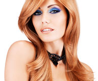 Beautiful woman with long red hairs with blue makeup Royalty Free Stock Photos