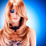Beautiful woman with long red hairs with blue makeup Royalty Free Stock Photo