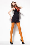 Beautiful woman with long legs dressed elegant posing in the studio - full body Royalty Free Stock Images
