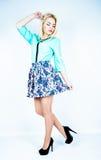 Beautiful woman with long legs dressed elegant posing in the studio stock photos