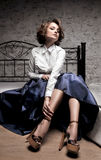 Beautiful woman in long skirt and white blouse Stock Photography