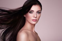 Beautiful woman with long smooth hair Stock Images