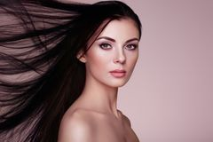 Beautiful woman with long smooth hair Stock Photos