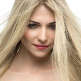 Beautiful woman with long straight blond hair. Stock Image