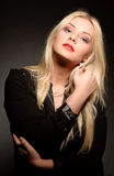 Beautiful woman with long straight blond hair. Fashion model. Posing at studio Stock Images