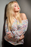 Beautiful woman with long straight blond hair. Fashion model. Posing at studio Royalty Free Stock Photos