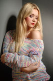 Beautiful woman with long straight blond hair. Fashion model. Posing at studio Royalty Free Stock Images