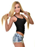 Beautiful woman with long straight blond hair. Fashion model posing at studio Stock Photos