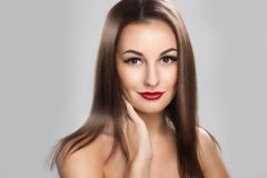 Beautiful woman with long straight brown hair Stock Images