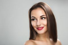 Beautiful woman with long straight brown hair Stock Photo