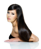 Beautiful woman with long straight hair. Portrait of beautiful young woman with long straight brown hair posing isolated on white background Stock Photography