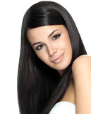 Beautiful woman with long straight hair. Fashion model posing at studio Royalty Free Stock Images
