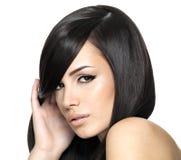 Beautiful woman with long straight hair. Fashion model posing at studio Royalty Free Stock Photos