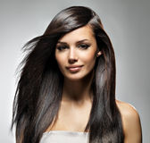 Beautiful woman with long straight hair. Fashion model posing at studio Royalty Free Stock Photo