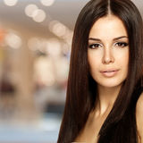 Beautiful woman with long straight hair. Fashion model posing at studio Stock Photography