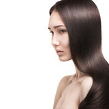 Beautiful woman with long straight hair. Isolated on white background Royalty Free Stock Images