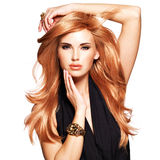 Beautiful woman with long straight red hair in a black dress. Royalty Free Stock Photos