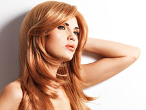 Beautiful woman with long straight red hair Stock Images