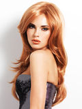 Beautiful woman with long straight red hair Stock Photo