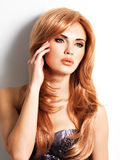 Beautiful woman with long straight red hair Stock Image