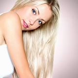 Beautiful woman with long straight white hair stock image