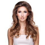 Beautiful woman with long wavy brown hair Royalty Free Stock Images