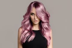 Beautiful woman with long wavy coloring hair. royalty free stock photo
