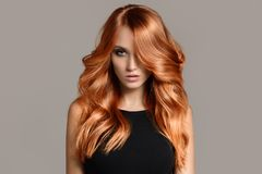 Beautiful woman with long wavy coloring hair. stock image