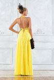 Beautiful woman in a long yellow dress. Royalty Free Stock Photos