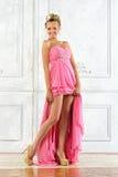 Beautiful woman in a long yellow dress. Stock Photo
