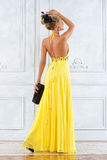 Beautiful woman in a long yellow dress. Stock Photos