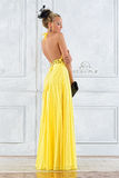 Beautiful woman in a long yellow dress. Stock Photography