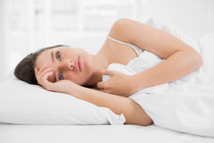 Beautiful woman looking away in bed Royalty Free Stock Photo