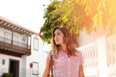 Beautiful woman looking away while walking Royalty Free Stock Image