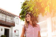 Beautiful woman looking away while walking Royalty Free Stock Image