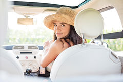 Beautiful woman looking back while driving car Royalty Free Stock Photo