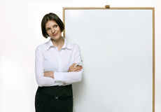 Beautiful woman looking at the blank billboard Royalty Free Stock Photography