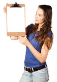 Beautiful woman looking at blank clipboard Royalty Free Stock Photos