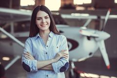 Woman and aircraft royalty free stock photography