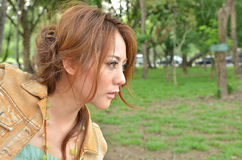 Beautiful woman looking into the distance Stock Photos